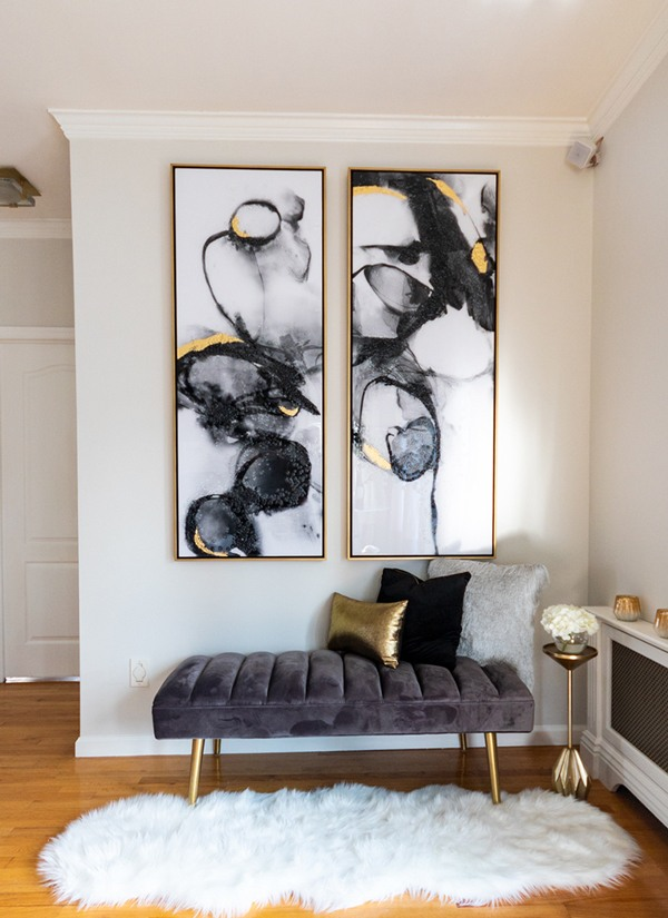 contemporary-black-and-gold-art-with-gray-velvet-bench-fur-rug-600x825