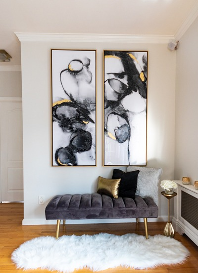 contemporary-black-and-gold-art-with-gray-velvet-bench-fur-rug-800x550