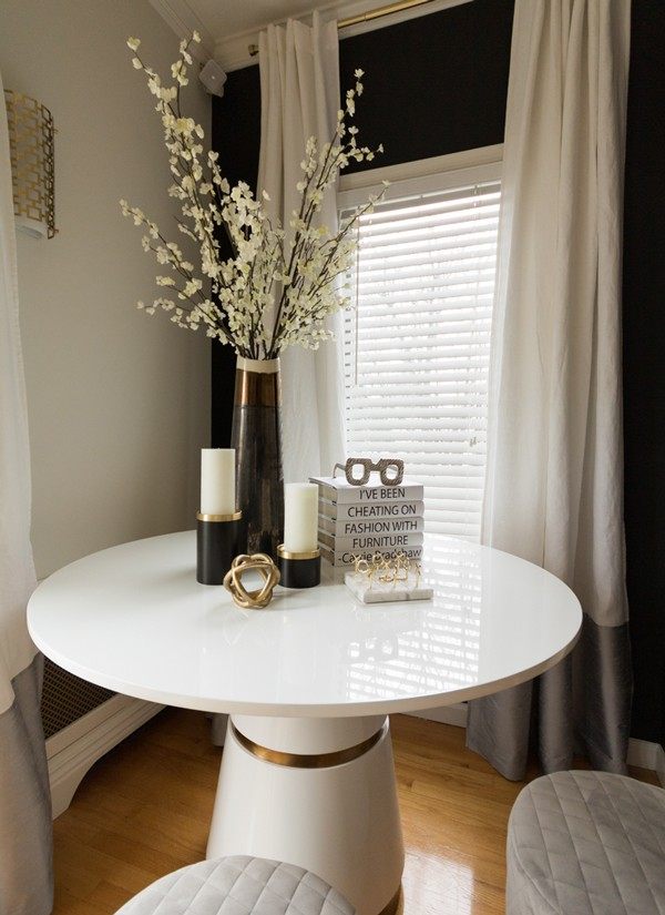 white-tov-table-with-gold-trim-and-book-quote-decor-600x825